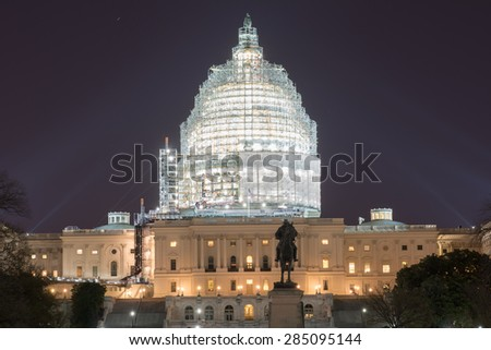 The Capitol Building of the United States of America at night with the dome under construction. - stock photo