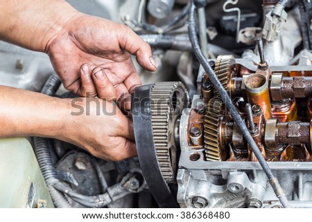 The car engine fixing by technician.