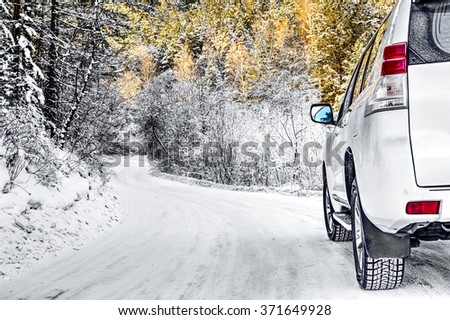 The car in the Siberian winter forest - stock photo