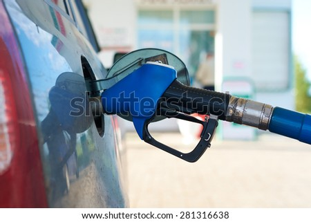 The car is fueled with gasoline at a gas station - stock photo