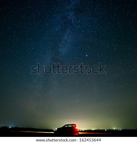The car of the tourist against the star sky. - stock photo