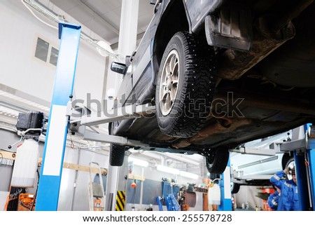 The car on the lift prepared to repair - stock photo