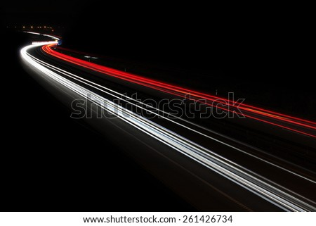 the car's light trails on the street long exposure - stock photo