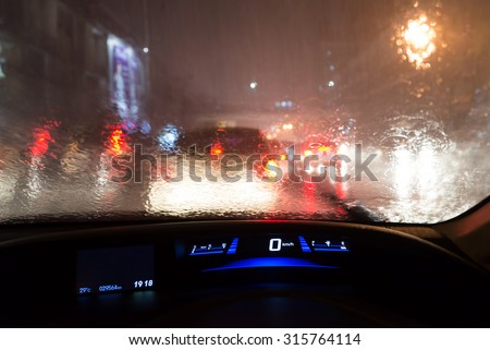 the car struck in traffic jam during hard rain - stock photo