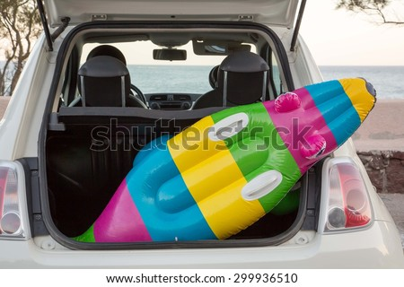 The car trunk full of beach accessories - stock photo