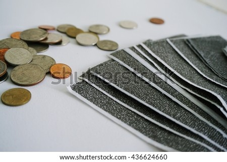 The carbon payslips on white background with the coins,Salary payroll slip.Soft focus. - stock photo