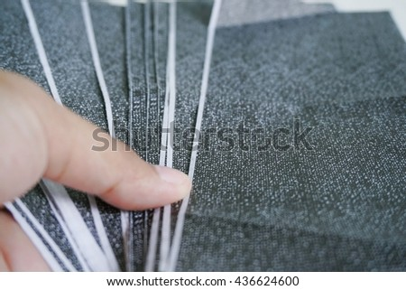 The carbon payslips on women hand,The Salary payroll slip.Soft focus. - stock photo