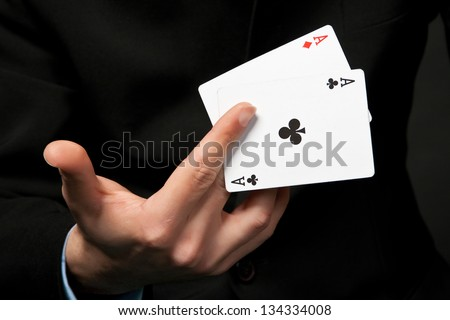 The cards is in the hand of lucky gambler. - stock photo