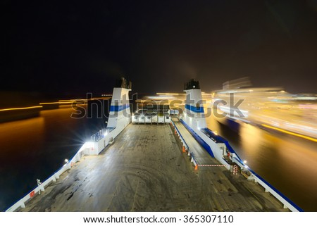 The Cargo ferry in motion at night.  - stock photo