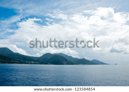 The Caribbean rain forest island Dominica. View from sea. - stock photo