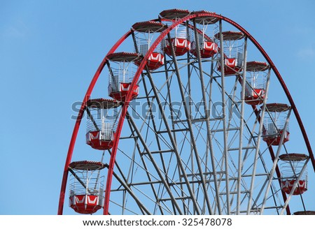 The Carriages of a Large Fun Fair Big Wheel. - stock photo
