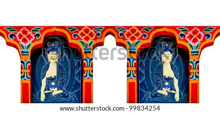 The Carving buddha status of bhutan style on wood.This is traditional and generic style in Thailand. No any trademark or restrict matter in this photo. - stock photo