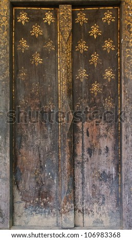 The Carving wood of door at thai temple - stock photo