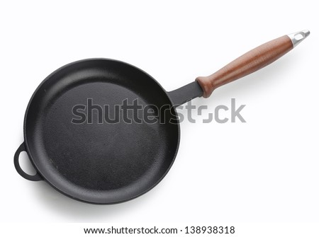 The cast iron frying pan on the white background - stock photo