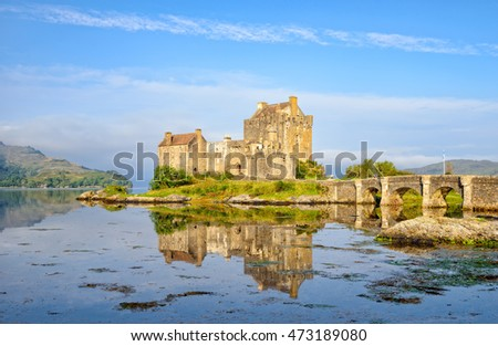 The castle at Eilean Donan reflected in the high tide on Loch Alsh