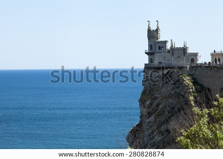 The castle by the sea is on the rock highly above water