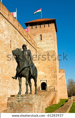 The castle in Gyula with sculpture of a knight - stock photo