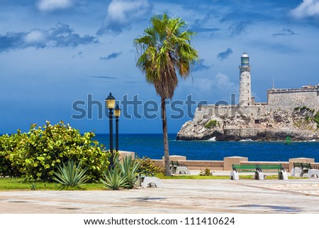 The castle of El Morro, a symbol of Havana, and a nearby romantic park on a day with a beautiful sky - stock photo