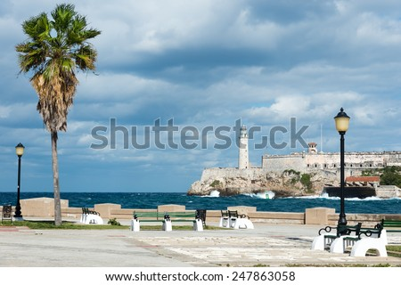 The castle of El Morro in Havana with a beautiful park with tropical palm trees on the foreground - stock photo