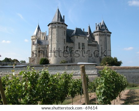 The castle of Saumur on the Loire river in France - stock photo