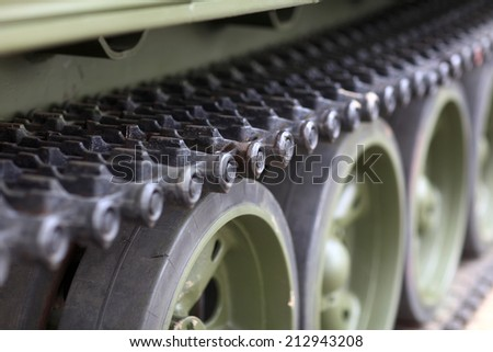 The caterpillar of the old russian tank - stock photo