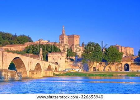 The Cathedral and Papal Palace (Palais des Papes) near the old bridge across Rhone river, Avignon, Provence, France - stock photo