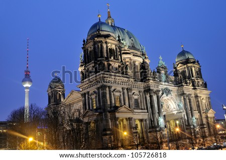 The cathedral and television tower in Berlin, Germany Long exposure night time shot. - stock photo