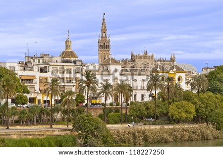 The cathedral and the Giralda view from the Guadalquivir river. These monuments are located in the famous city of Sevilla, Spain.