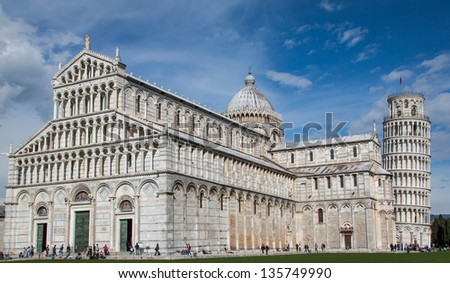 The cathedral in Pisa and the leaning tower - stock photo