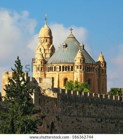 The Catholic Church of Dormition in Jerusalem. The morning sun illuminates the dome and the tower of the abbey. - stock photo