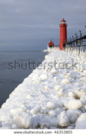 the catwalk to the lighthouses in Grand Haven, Michigan in winter - stock photo