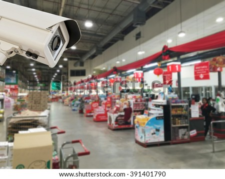 The CCTV Security Camera operating in counter service cashier at supermarket store blur background. - stock photo