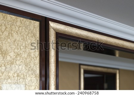 The ceiling, gold wall paper, wow frames of house, day light in the morning. - stock photo