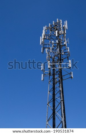 The cell tower with brilliant blue skies in the background.
