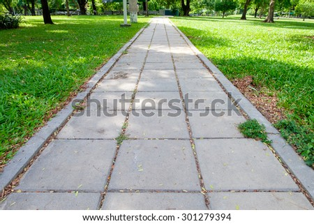 The cement block walkway in the park - stock photo