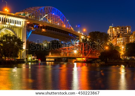 The Center Street Swing bridge moves back into place over the river after allowing a boat to pass, with motion blur from the movement