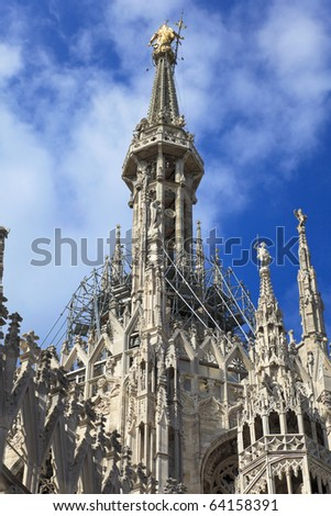 The central spire of a cathedral Duomo, Milan, Italy - stock photo