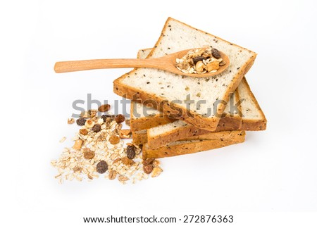 the cereal and black sesame bread with whole grain cereal flakes which mixed warming cinnamon , red skin apple , golden raisins and roasted hazelnuts on white background