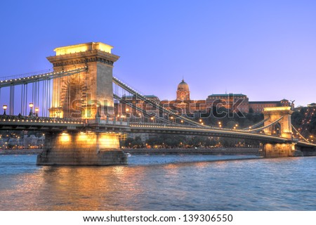 The Chain Bridge is a suspension bridge that spans the River Danube between Buda and Pest, the western and eastern sides of Budapest.In the background there is Buda Castle. - stock photo