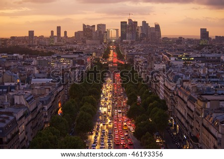 The Champs Elysees and La Defense at Sunset - stock photo