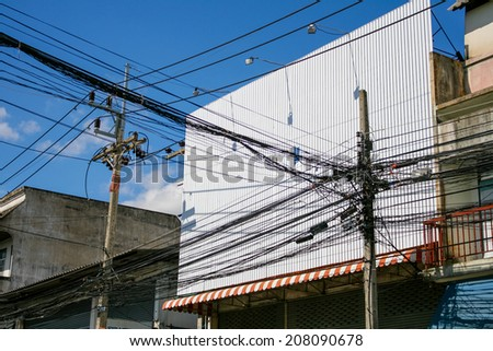 The chaos of cables and wires in town - stock photo