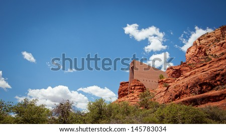 The Chapel of the Holy Cross towering between red rocks in Sedona  - stock photo