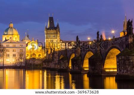 The Charles Bridge (Czech: Karluv Most) is a famous historic bridge that crosses the Vltava river in Prague, Czech Republic. Night picture. - stock photo