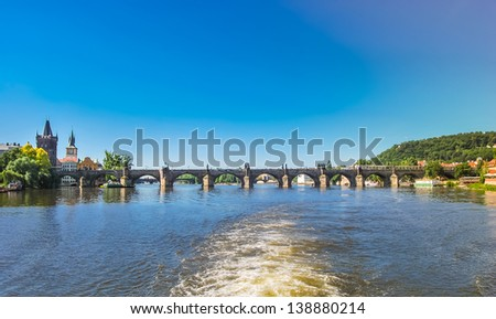 The Charles Bridge in Prague shot from a boat - stock photo