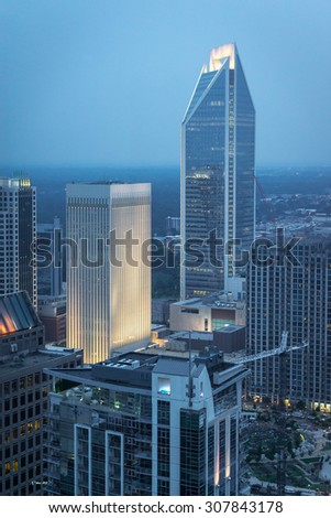 The Charlotte, North Carolina, skyline taken from high above street level after the sunset. - stock photo