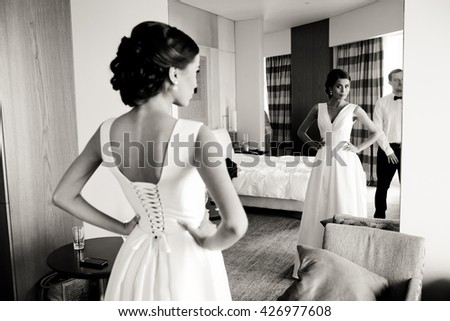 The charming bride look at mirror