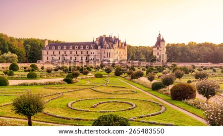 The Chateau de Chenonceau at sunset, France. This castle is located near the small village of Chenonceaux in the Loire Valley, was built in the 15-16 centuries and is a tourist attraction. - stock photo