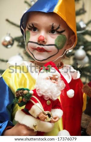 The cheerful clown near Christmas tree - stock photo