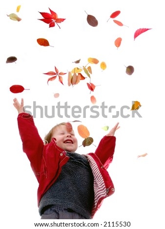 The cheerful little boy throws autumn leaves on a white background
