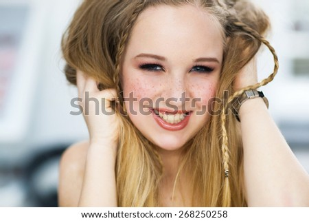 The cheerful woman with freckles laughs - stock photo